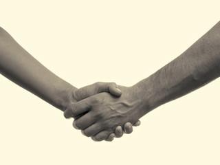 handshake between man and woman