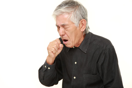 senior Japanese man coughing