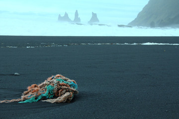 Abandoned colored sailing ropes on a black sand beach in Iceland