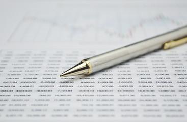 Pencil on business graph, financial concept