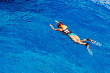 Young woman in swimsuit snorkeling