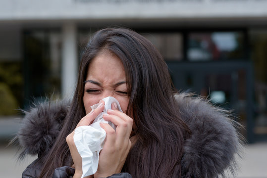 Woman with a seasonal winter cold and flu