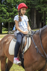 Young girl riding a horse