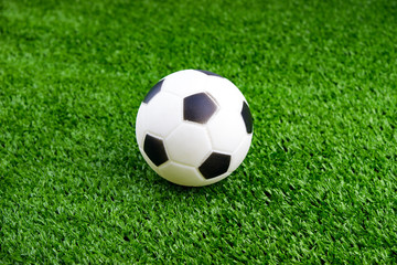 Toy ball on artificial grass background
