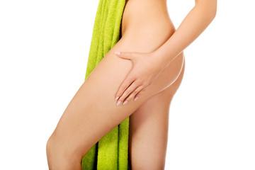 Sexy female body in green towel