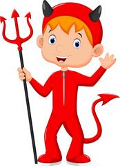 Cute little boy wearing a red devil costume