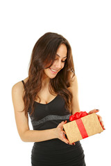 Young beautiful brunette woman with a gift on white background