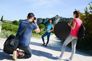 group of young student photographer taking pictures on photography shooting workshop course outdoor