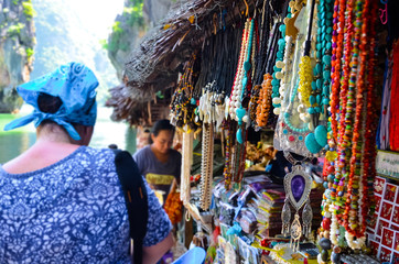Woman on the market of souvenirs