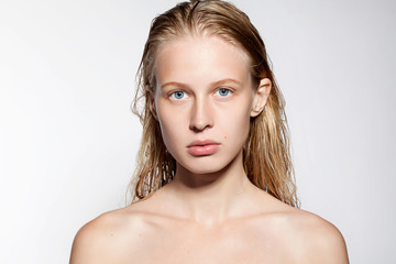 Woman without a make-up with perfect skin and long blond hair