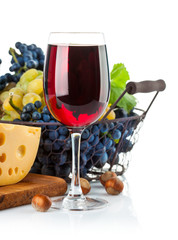 Glass red wine with grapes and cheese. Isolated on white