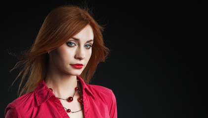 Portrait of beautiful redhead woman.