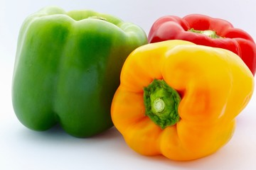 Colorful Capsicums on White Background