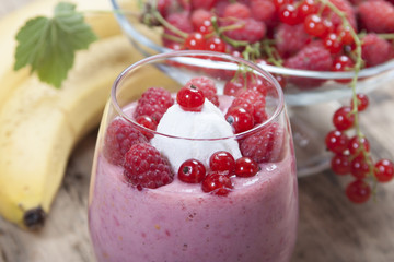 Smoothie of banana, raspberry and red currant decorated ice crea