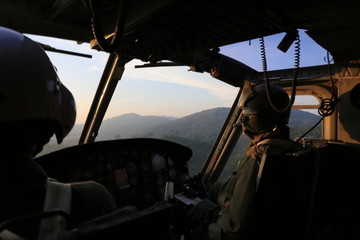silhouette helicopter cockpit view  on sunrise
