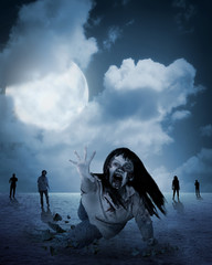 Zombie woman come out from ground under full moon