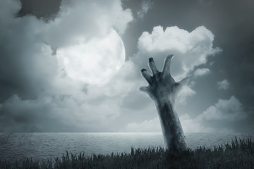 Zombie hand come out from ground
