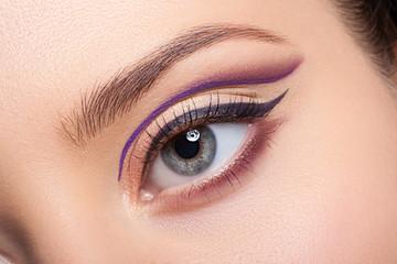 Beautiful and colorful eye makeup.