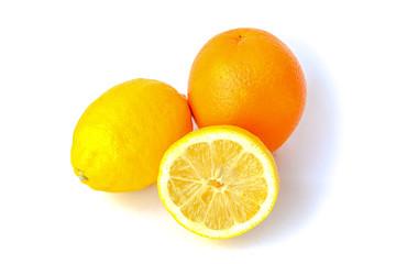 Two lemons and orange isolated on white.