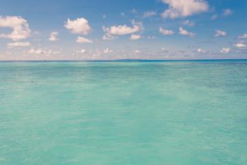 blue sky and water of ocean - vintage film filter