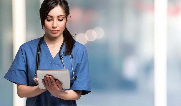 Nurse using a digital tablet. Large copy-space