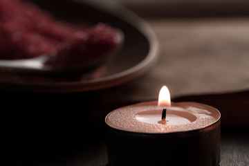 Beautiful Spa composition with aroma candles and empty vintage open book on wooden background. Treatment, aromatherapy