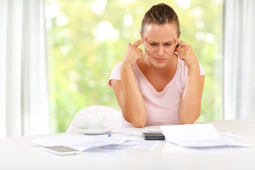 Young woman stressed over large home bills