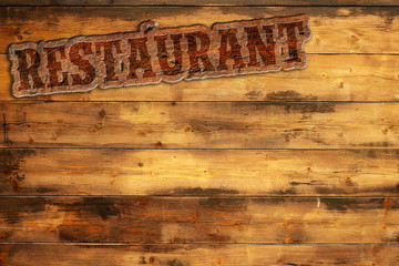 """signboard """"restaurant"""" nailed to a wooden wall"""