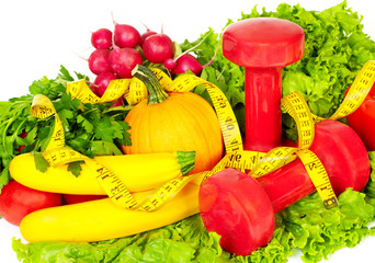 Fototapete - Fresh vegetables and dumbbells.