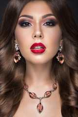 Beautiful woman with arabic make-up, red lips and curls. Beauty face.