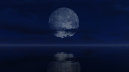 Cloudy night sky with a big full moon above calm water surface