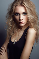 Portrait of young beautiful girl with blonde hair