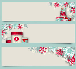 Three christmas banners with giftboxes and snowflakes