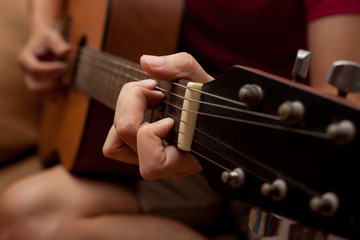 hand playing folk guitar