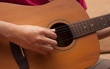 hand playing folk guitar