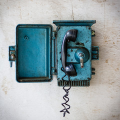 Old blue telephone. Communication concept.