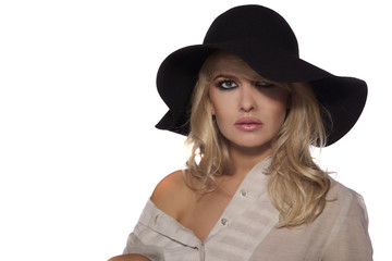 portrait of a beautiful blonde in retro style isolated on white background. in black hat