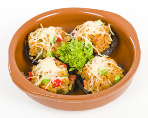 Stuffed Mushrooms - Mushrooms topped with cooked spicy rice and cheese.