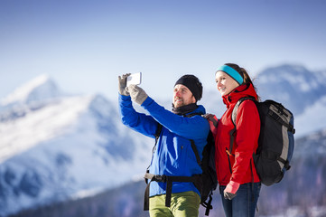 Young couple taking selfie on a hike