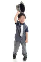 Happy asian boy holding a hat