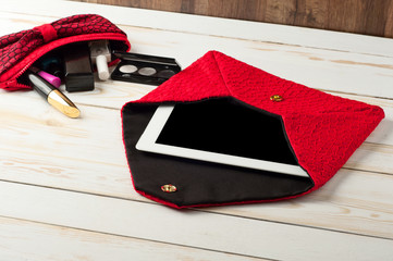 open red pen female handbag with tablet computer in a white wood