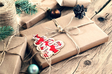 Christmas gifts on wooden table closeup. Rural or wooden style