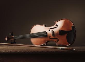 Violin on an old table still life