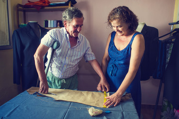 Mature couple working together on a tailoring
