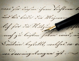 Calligraphic handwritten text and vintage ink pen. Retro style