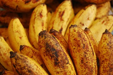 Ripe yellow bananas with spots photo