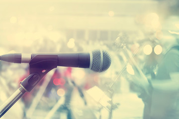 Microphone with guitarist on stage, pastel color and soft concept