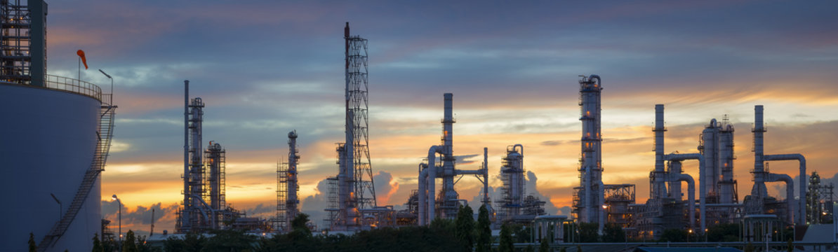 Silhouette of petrochemical plant or Oil and gas refinery in sunrise