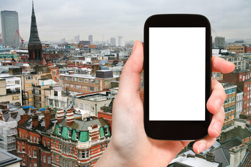 smartphone with cut out screen and London skyline