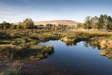 The Bullaque River at its pass through Porzuna, La Mancha, Ciudad Real, Spain